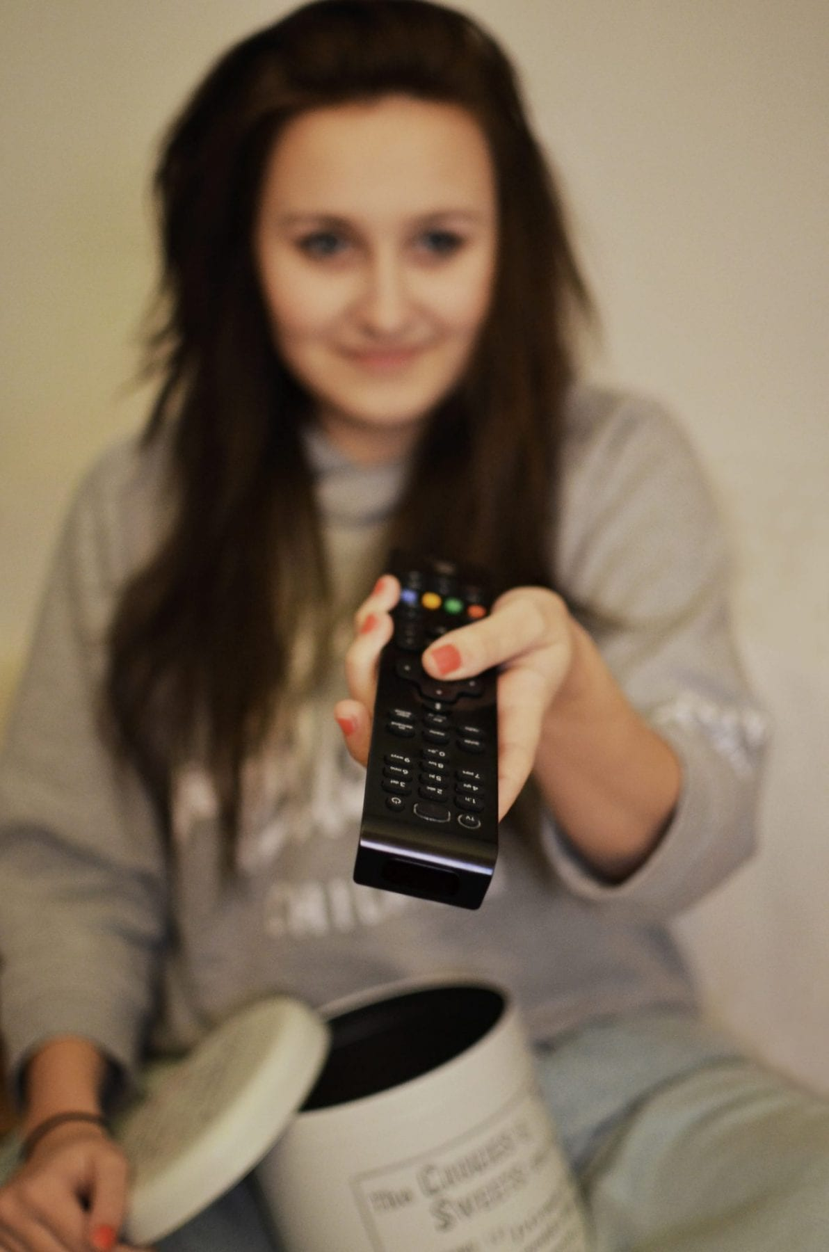 woman-girl-remote-watching (1)
